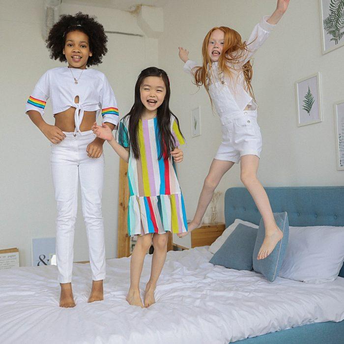 three girls jumping